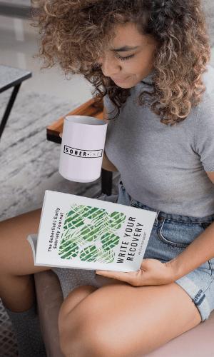 woman holding soberish mug reading soberish early sobriety journal