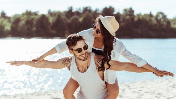 happy couple on beach enjoying sobriety