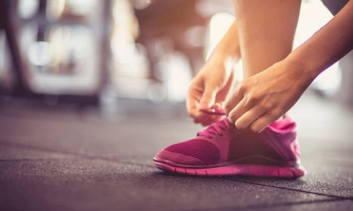 lacing up sneakers to start small habit of fitness