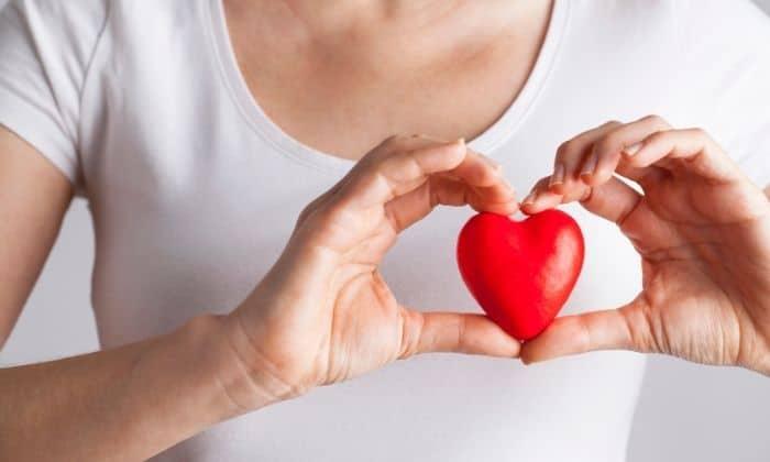 woman holding tiny heart