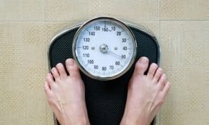 toes on a scale to show sobriety and weight loss