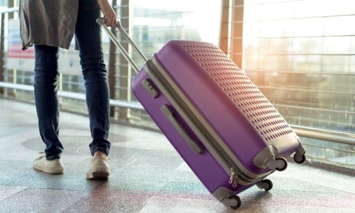 woman spending holidays alone with her suitcase at the airport